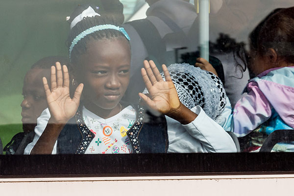 <div class='meta'><div class='origin-logo' data-origin='none'></div><span class='caption-text' data-credit='Geert Vanden Wijngaert/AP Photo'>A young girl looks out of the window of a bus after being evacuated from the Brussels airport.</span></div>