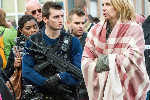<div class='meta'><div class='origin-logo' data-origin='none'></div><span class='caption-text' data-credit='Geert Vanden Wijngaert/AP Photo'>A police officer stands guard as people are evacuated from the Brussels airport.</span></div>