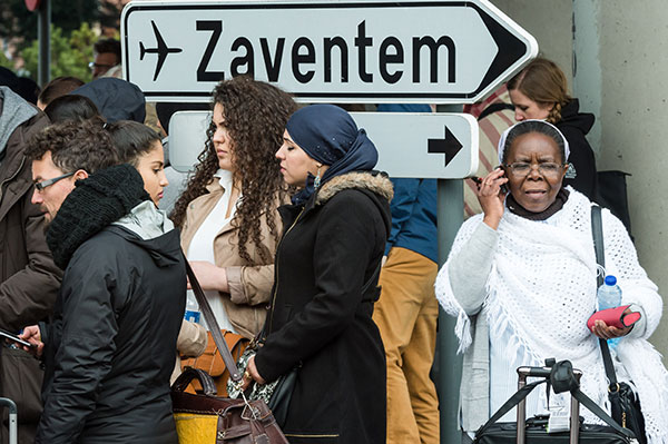 <div class='meta'><div class='origin-logo' data-origin='none'></div><span class='caption-text' data-credit='Geert Vanden Wijngaert/AP Photo'>People stand near the Brussels airport after being evacuated following explosions that rocked the facility in Brussels, Belgium, Tuesday.</span></div>