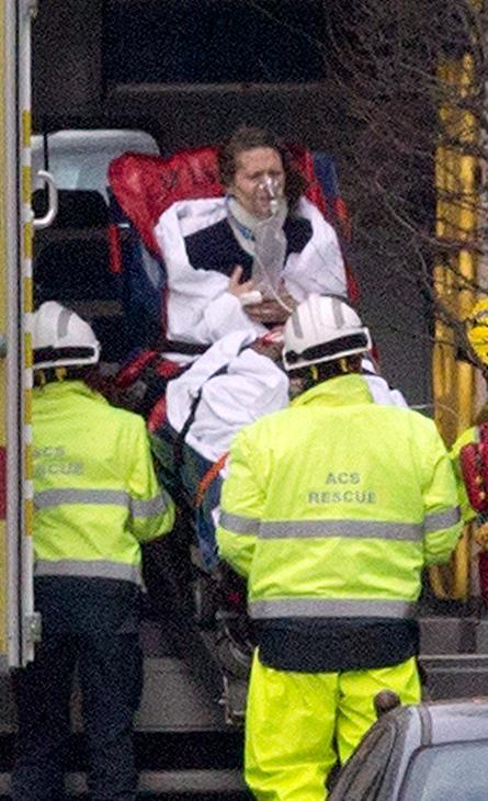 <div class='meta'><div class='origin-logo' data-origin='AP'></div><span class='caption-text' data-credit='Virginia Mayo/AP'>A woman is evacuated in an ambulance by emergency services after a explosion in a main metro station in Brussels on Tuesday, March 22, 2016.</span></div>