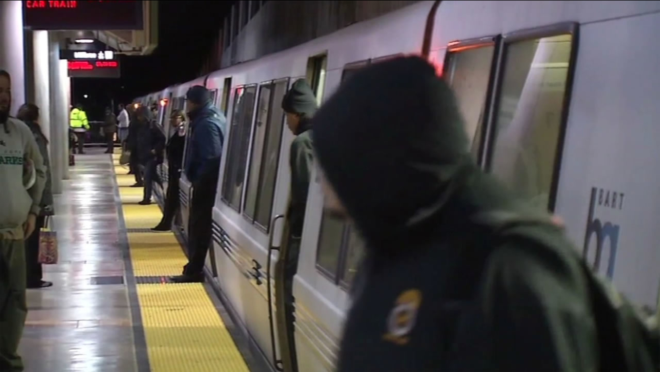 Passengers exit a BART train on Tuesday, March 22, 2016.