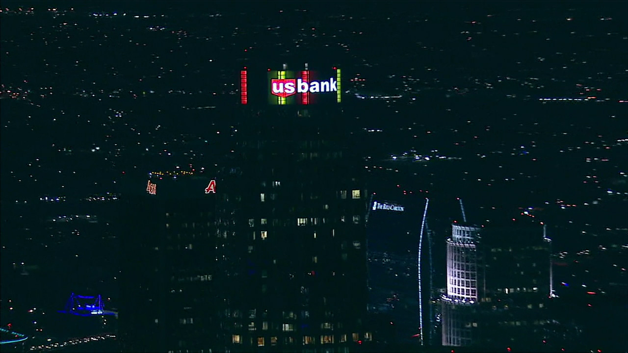 The U.S. Bank Tower in downtown Los Angeles, the tallest building west of the Mississippi, is illuminated in the colors of the Belgian flag following the Brussels attacks.