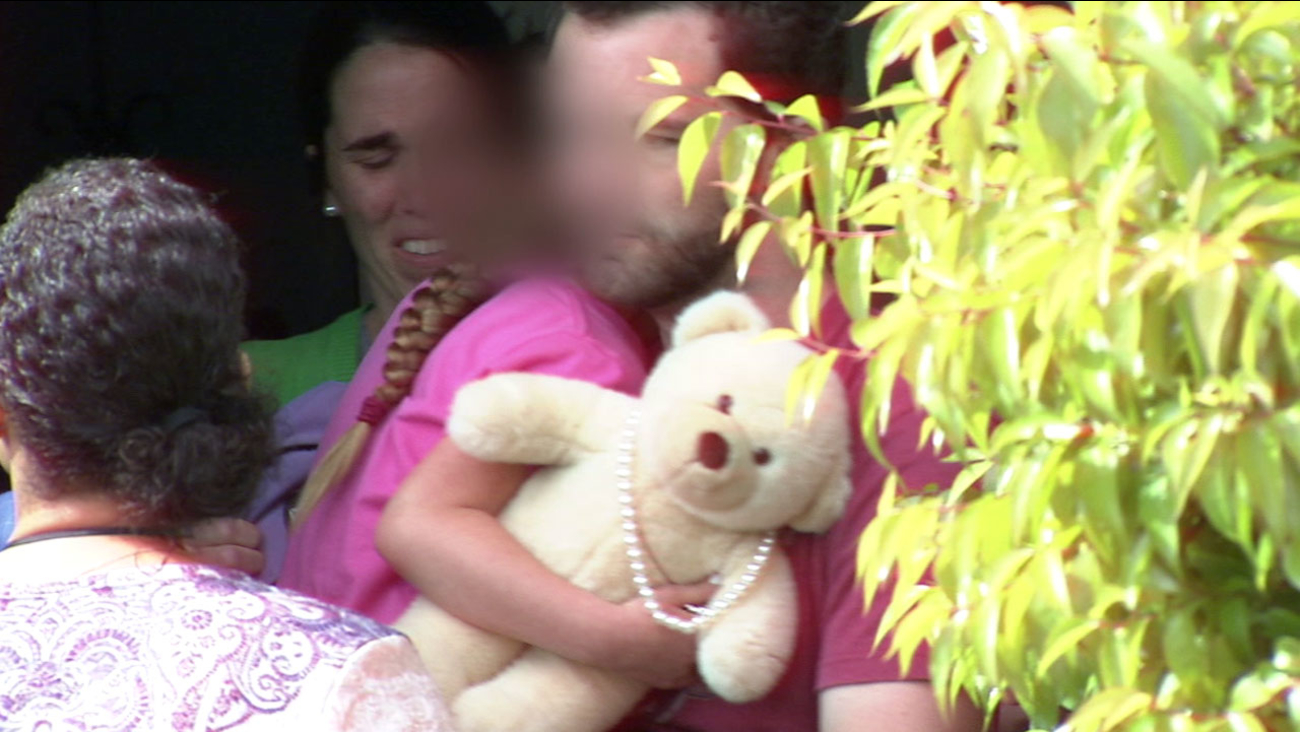 Lexi cried and clutched a stuffed bear on Monday, March 21, 2016 as Rusty Page carried her out of his Santa Clarita home and social workers whisked her away.