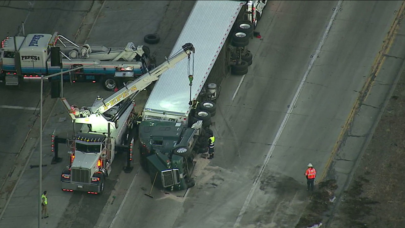A big rig crashed and overturned on the connector road from the southbound 5 Freeway to the 60 Freeway in East Los Angeles on Thursday, March 24, 2016.