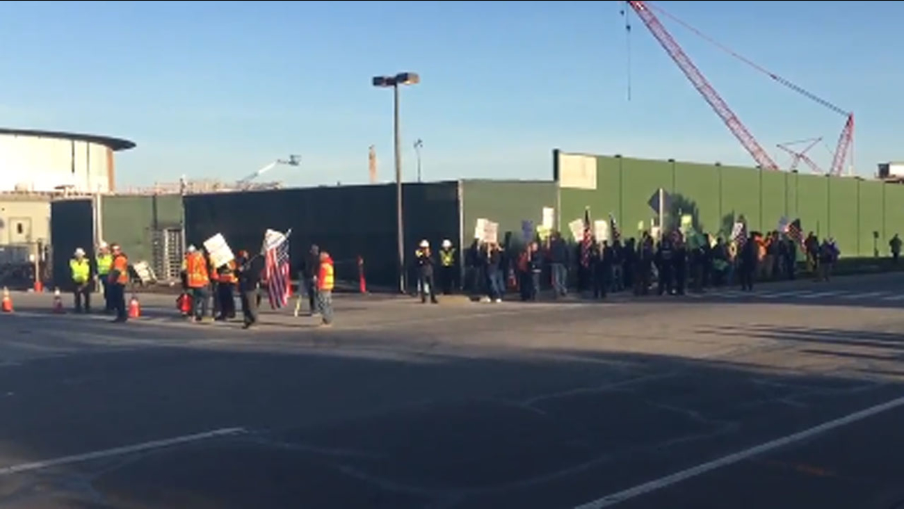 Protest outside of Apple's new campus in Cupertino, California, Thursday, March 24, 2016.