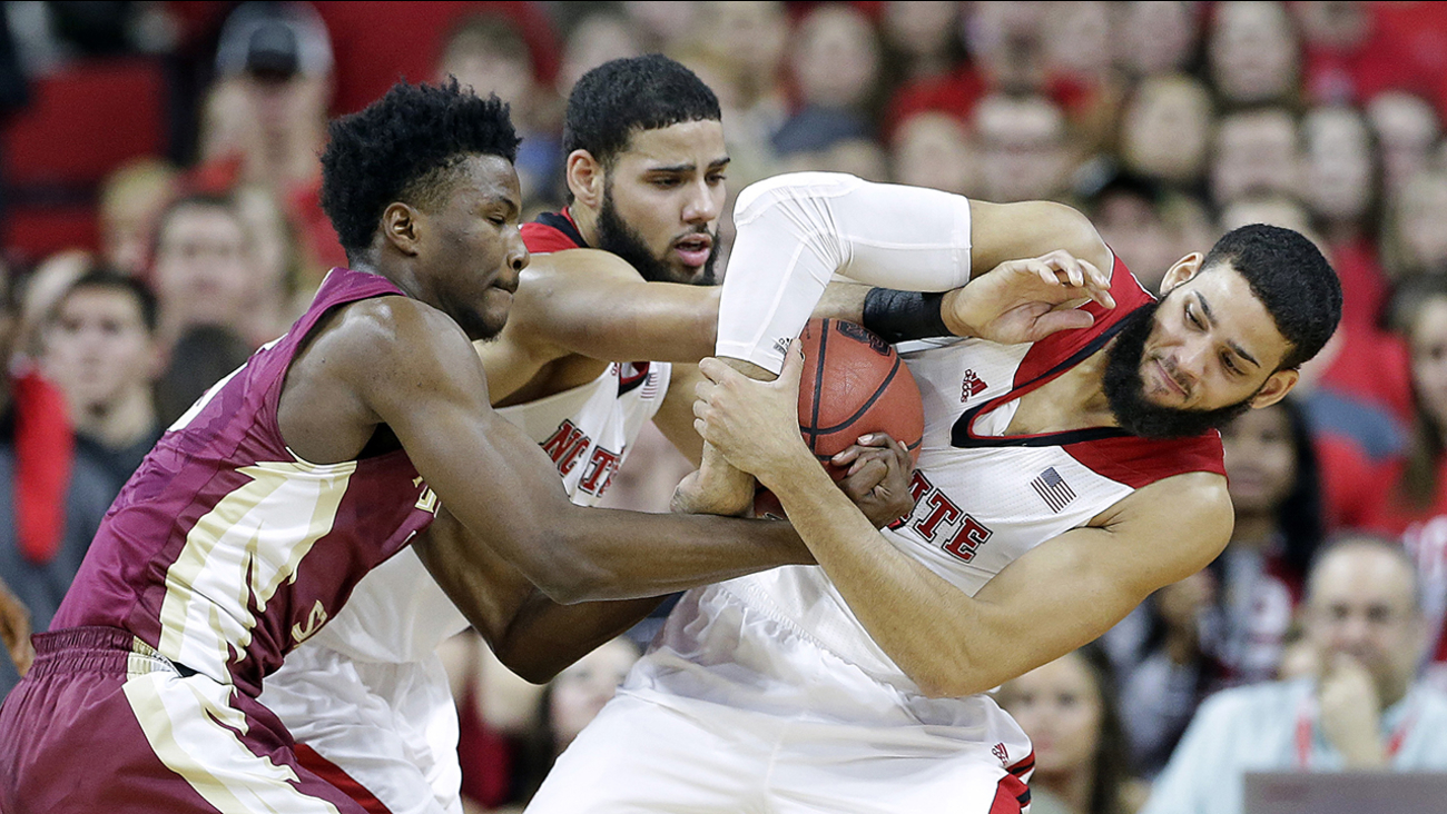 N.C. State's Caleb Martin, center, and Cody Martin, right, battle against Florida State's Malik Beasley.