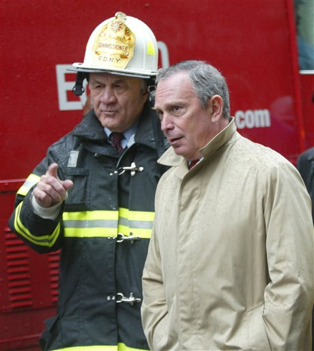 <div class='meta'><div class='origin-logo' data-origin='AP'></div><span class='caption-text' data-credit='AP'>New York Mayor Michael Bloomberg, right, walks with New York Fire Commissioner Nicholas Scoppetta after touring the damage caused by a building explosion in Manhattan.</span></div>