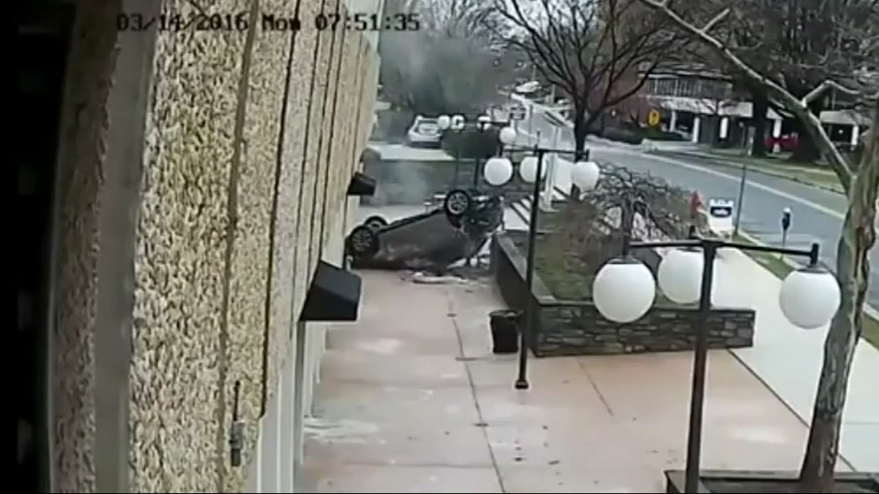 Police in Maryland released dramatic surveillance video showing an SUV falling four stories  before landing on its roof March 24, 2016.