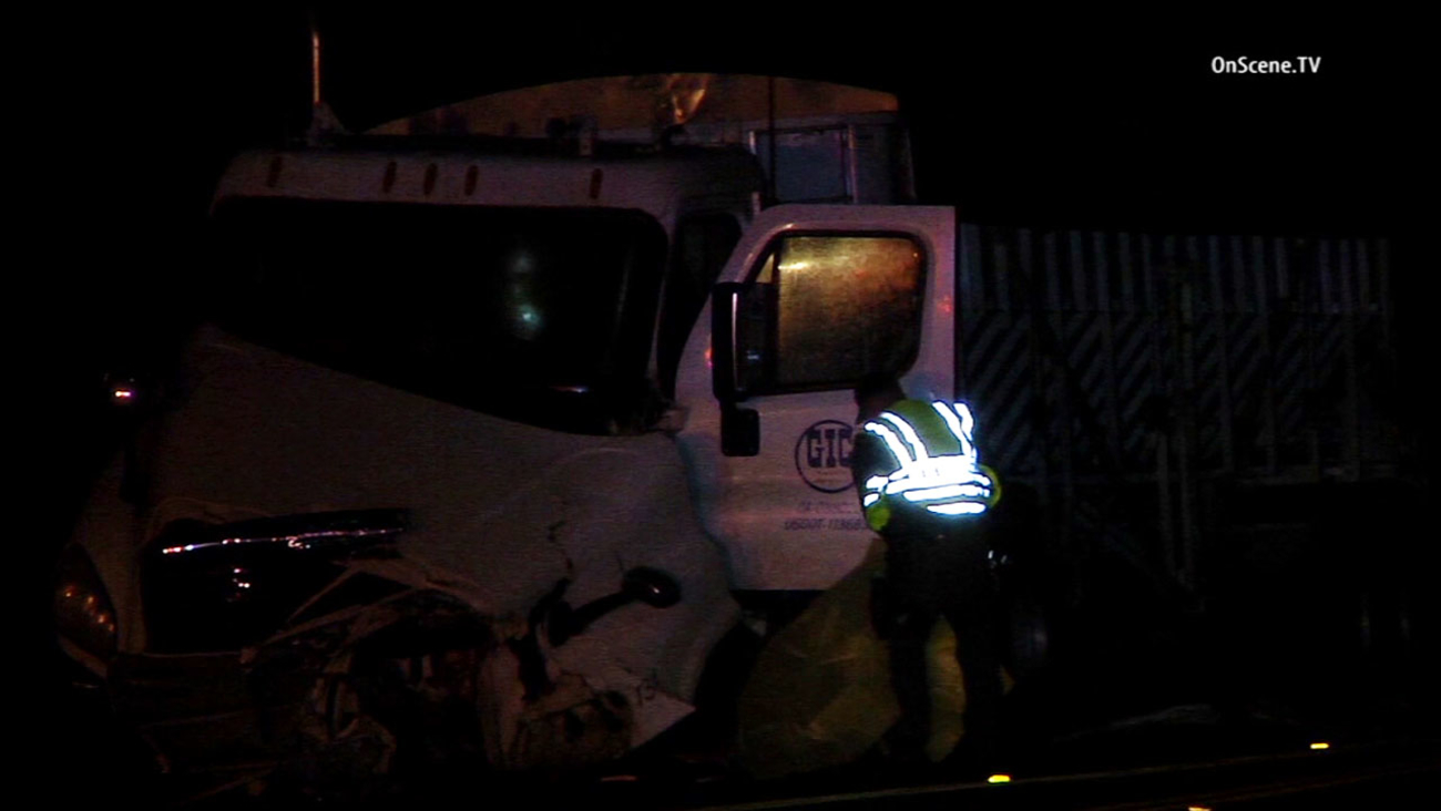 Sheriff's deputies respond to a fatal crash involving a big rig and a sedan on Ortega Highway near Antonio Parkway in San Juan Capistrano Friday, March 25, 2016.