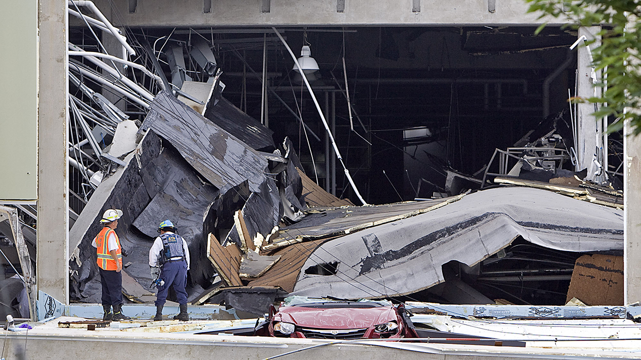 Investigators survey the wreckage during recovery operations Wednesday, June 10, 2009, at ConAgra Foods Inc., in Garner