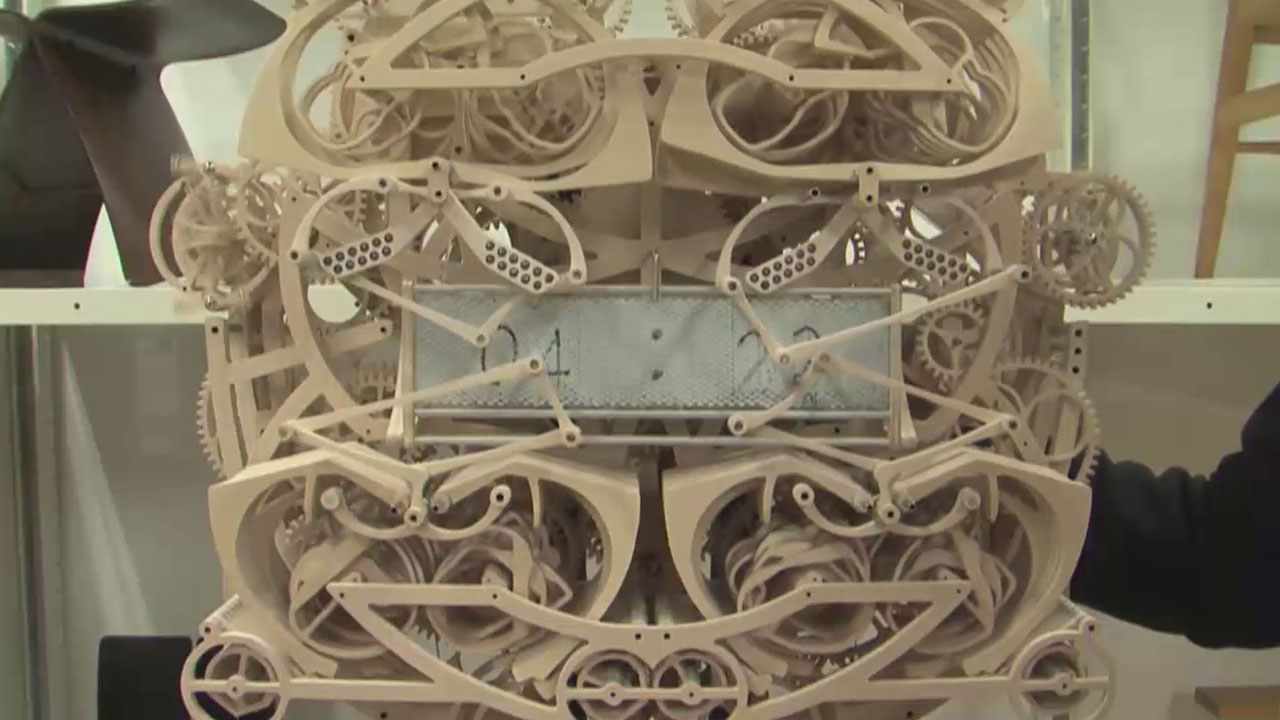 A clock created by a Japanese art student is made completely of wood and writes down the time every minute.