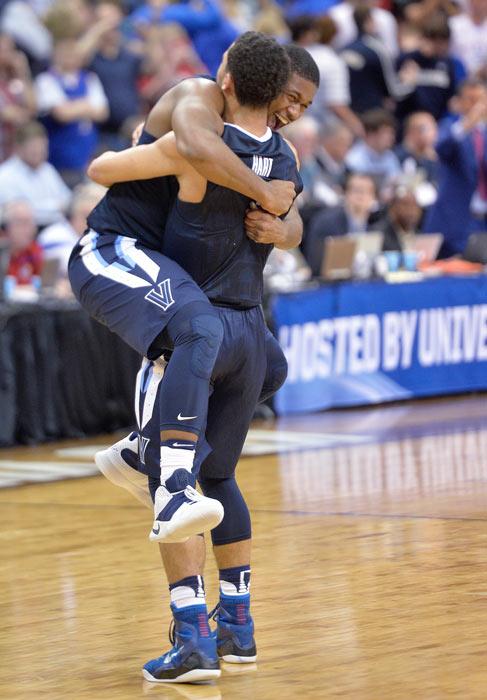 "<div class=""meta image-caption""><div class=""origin-logo origin-image ap""><span>AP</span></div><span class=""caption-text"">Villanova forward Kris Jenkins, left, celebrates with Villanova forward Kris Jenkins after a regional final men's college basketball game in the NCAA Tournament against Kansas. (AP Photo/Timothy D. Easley)</span></div>"