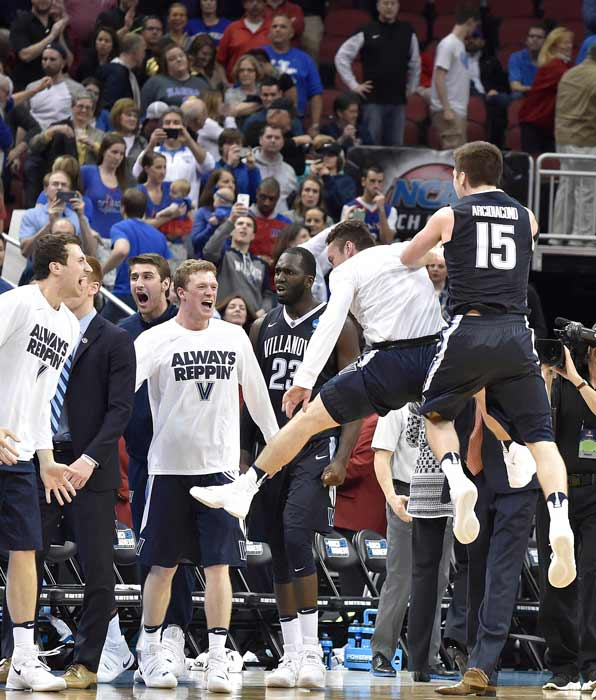 """<div class=""""meta image-caption""""><div class=""""origin-logo origin-image ap""""><span>AP</span></div><span class=""""caption-text"""">Villanova players celebrate after a regional final men's college basketball game against Kansas in the NCAA Tournament, Saturday, March 26, 2016, in Louisville, Ky. (AP Photo/John Flavell)</span></div>"""