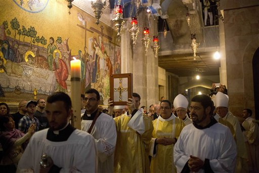 "<div class=""meta image-caption""><div class=""origin-logo origin-image none""><span>none</span></div><span class=""caption-text"">Christian clergymen participate in the Easter Sunday procession at the Church of the Holy Sepulchre, in Jerusalem's Old City, Israel. (AP Photo/Ariel Schalit) (AP)</span></div>"