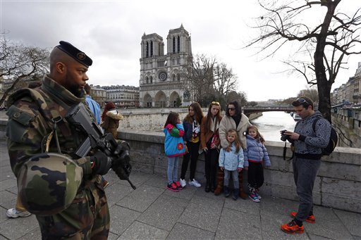 "<div class=""meta image-caption""><div class=""origin-logo origin-image none""><span>none</span></div><span class=""caption-text"">French soldier patrols as worshipers and tourists arrive for the Easter mass at Notre Dame Cathedral, in Paris, France, Sunday, March 27, 2016. (AP Photo/Francois Mori) (AP)</span></div>"