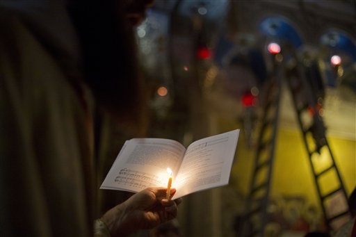 "<div class=""meta image-caption""><div class=""origin-logo origin-image none""><span>none</span></div><span class=""caption-text"">A Christian clergyman holds a candle and a holy book in Jerusalem's Old City, Sunday, March 27, 2016. (AP Photo/Ariel Schalit) (AP)</span></div>"
