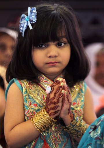 "<div class=""meta image-caption""><div class=""origin-logo origin-image none""><span>none</span></div><span class=""caption-text"">A Christian girl prays during an Easter service at St Anthony's Church in Lahore, Pakistan,  (AP Photo/K.M. Chaudary) (AP)</span></div>"