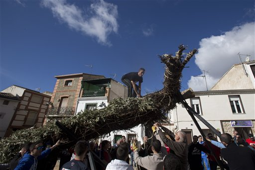 "<div class=""meta image-caption""><div class=""origin-logo origin-image none""><span>none</span></div><span class=""caption-text"">A cross is erected in the village square in Tielmes, Spain (AP Photo/Paul White) (AP)</span></div>"