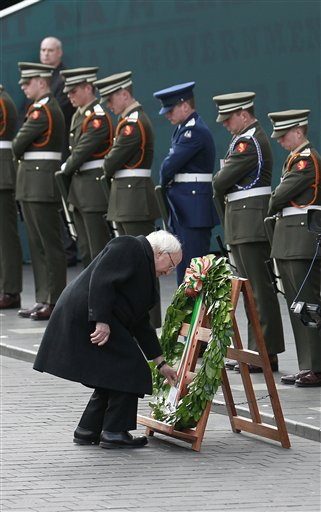 "<div class=""meta image-caption""><div class=""origin-logo origin-image none""><span>none</span></div><span class=""caption-text"">Irish President Michael D Higgins lays a wreath at the General Post Office on O'Connell street, Dublin, Ireland. (AP Photo/Peter Morrison) (AP)</span></div>"