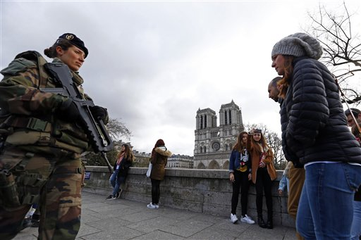 "<div class=""meta image-caption""><div class=""origin-logo origin-image none""><span>none</span></div><span class=""caption-text"">French forces soldier patrols as worshipers and tourists arrive for the Easter mass at Notre Dame Cathedral, in Paris, France, Sunday, March 27, 2016. (AP Photo/Francois Mori) (AP)</span></div>"