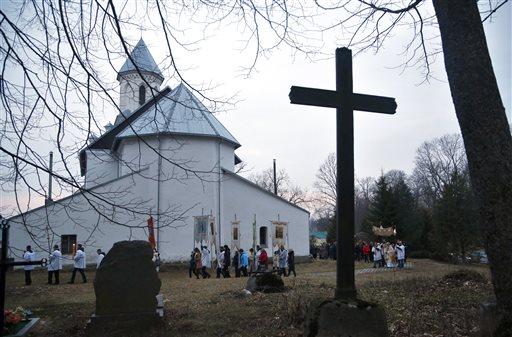 "<div class=""meta image-caption""><div class=""origin-logo origin-image none""><span>none</span></div><span class=""caption-text"">Devotees carry gonfalons during Easter Sunday rites in the village of Vselyub, 150 kilometers (93 miles) west of Minsk, Belarus. (AP Photo/Sergei Grits) (AP)</span></div>"