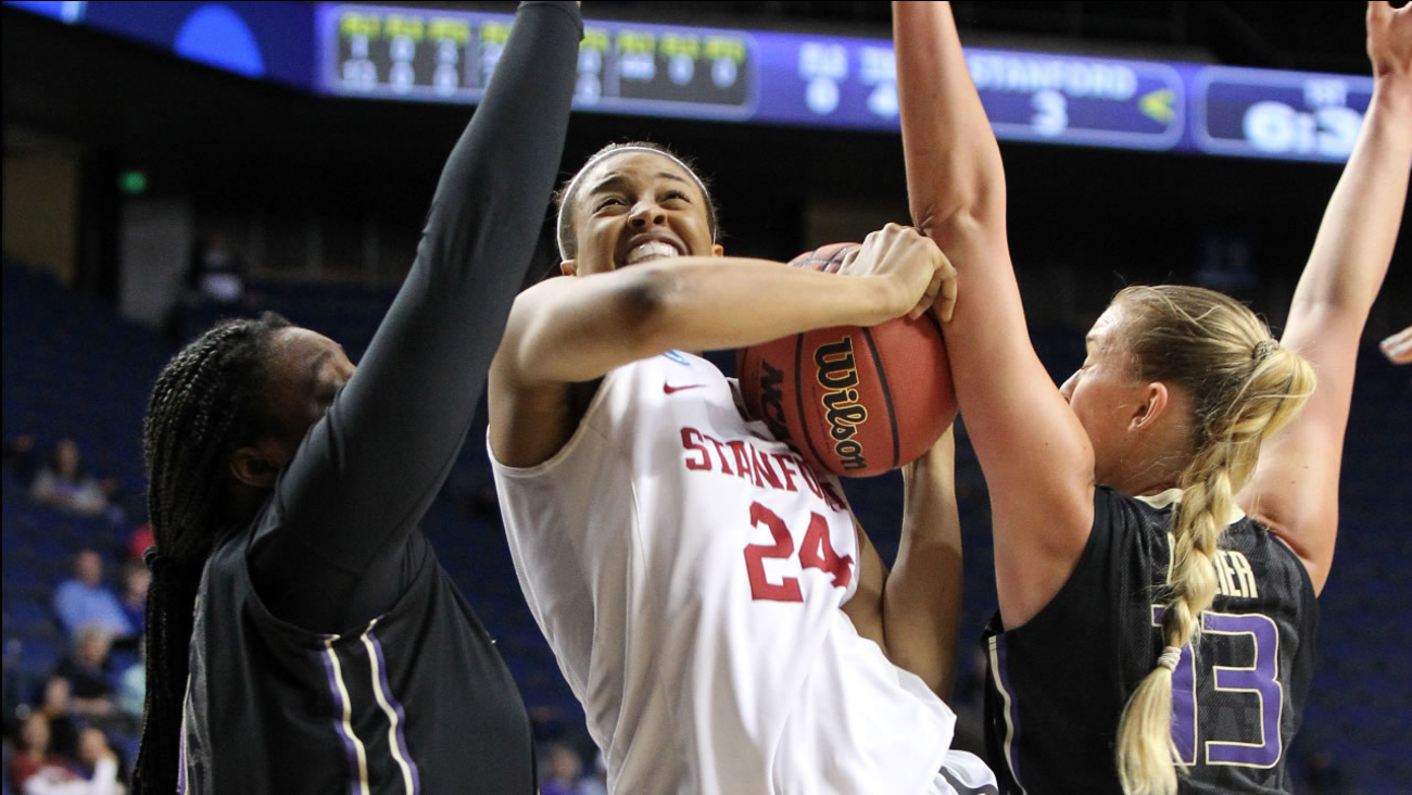 Stanford's Erica McCall splits the Washington defense during a regional final women's college basketball game in the NCAA Tournament in Lexington, Ky., Sunday, March 27, 2016.