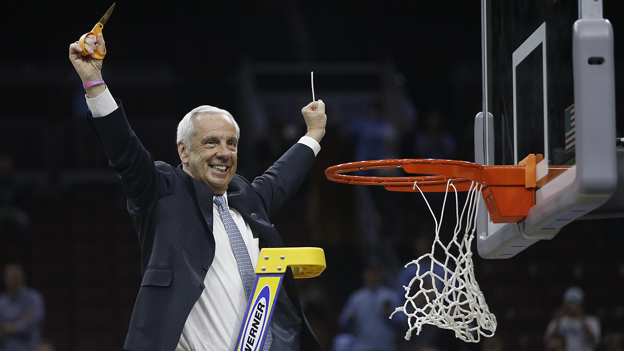 North Carolina head coach Roy Williams reacts after cutting the net after a regional final men's college basketball game against Notre Dame in the NCAA Tournament