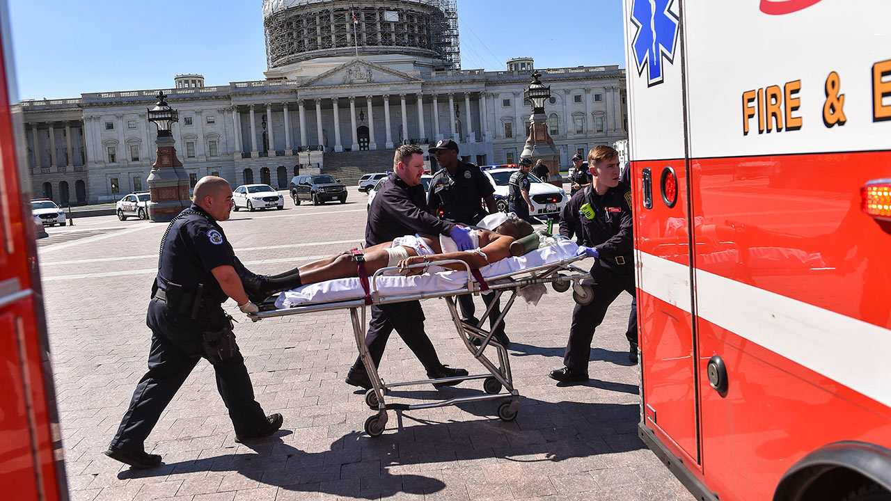 Police and EMS personnel transport the person believed to be the gunman away from the shooting scene at the U.S. Capitol Visitor Center on March 28, 2016 in Washington, D.C.