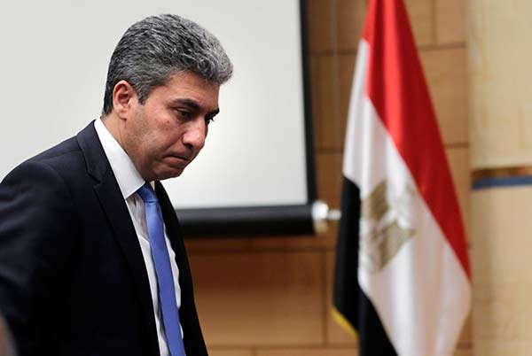 """<div class=""""meta image-caption""""><div class=""""origin-logo origin-image none""""><span>none</span></div><span class=""""caption-text"""">Egyptian Minister of Civil Aviation Sharif Fathy leaves a press conference at the Ministry headquarters in Cairo, Egypt, Tuesday, March 29, 2016. (Amr Nabil/AP Photo)</span></div>"""