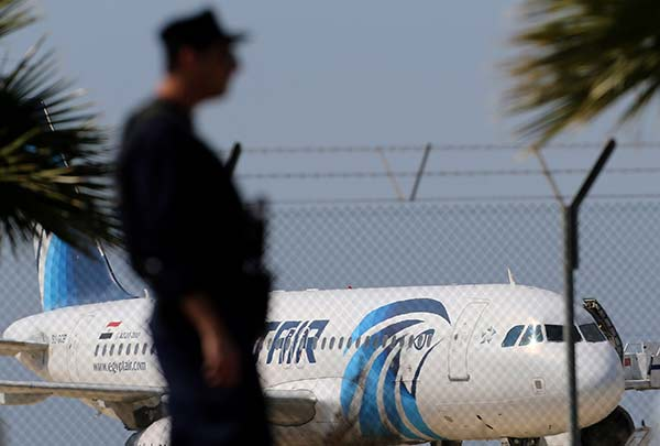 """<div class=""""meta image-caption""""><div class=""""origin-logo origin-image none""""><span>none</span></div><span class=""""caption-text"""">A police officer stands guard by the fence of the airport as a hijacked EgyptAir aircraft is seen after landing at Larnaca Airport in Cyprus Tuesday, March 29, 2016. (Petros Karadjias/AP Photo)</span></div>"""