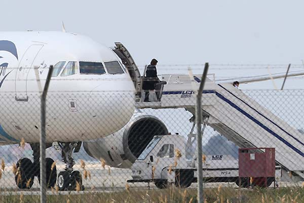 """<div class=""""meta image-caption""""><div class=""""origin-logo origin-image none""""><span>none</span></div><span class=""""caption-text"""">A passenger leaves a hijacked EgyptAir aircraft after landing at Larnaca Airport in Cyprus Tuesday, March 29, 2016. (Petros Karadjias/AP Photo)</span></div>"""