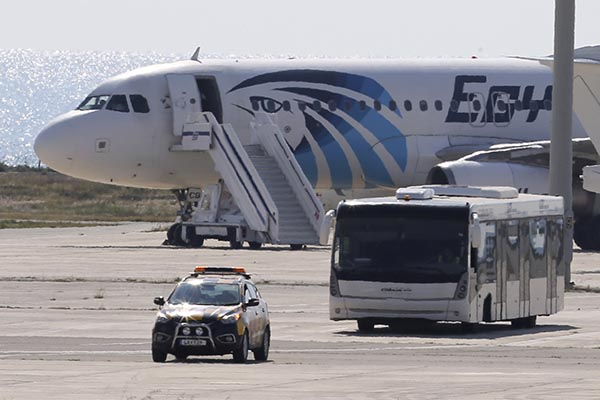 """<div class=""""meta image-caption""""><div class=""""origin-logo origin-image none""""><span>none</span></div><span class=""""caption-text"""">A bus carries passengers from the hijacked EgyptAir aircraft after it landed at Larnaca airport Tuesday, March 29, 2016. (Petros Karadjias/AP Photo)</span></div>"""
