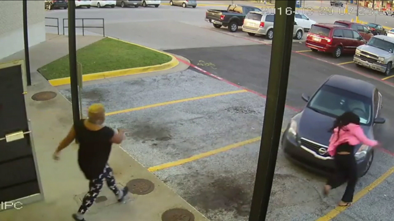 A 7-year-old girl leaped from a moving car as her mother held onto the trunk of the vehicle during a carjacking caught on surveillance video in Dallas on Tuesday, March 29, 2016.