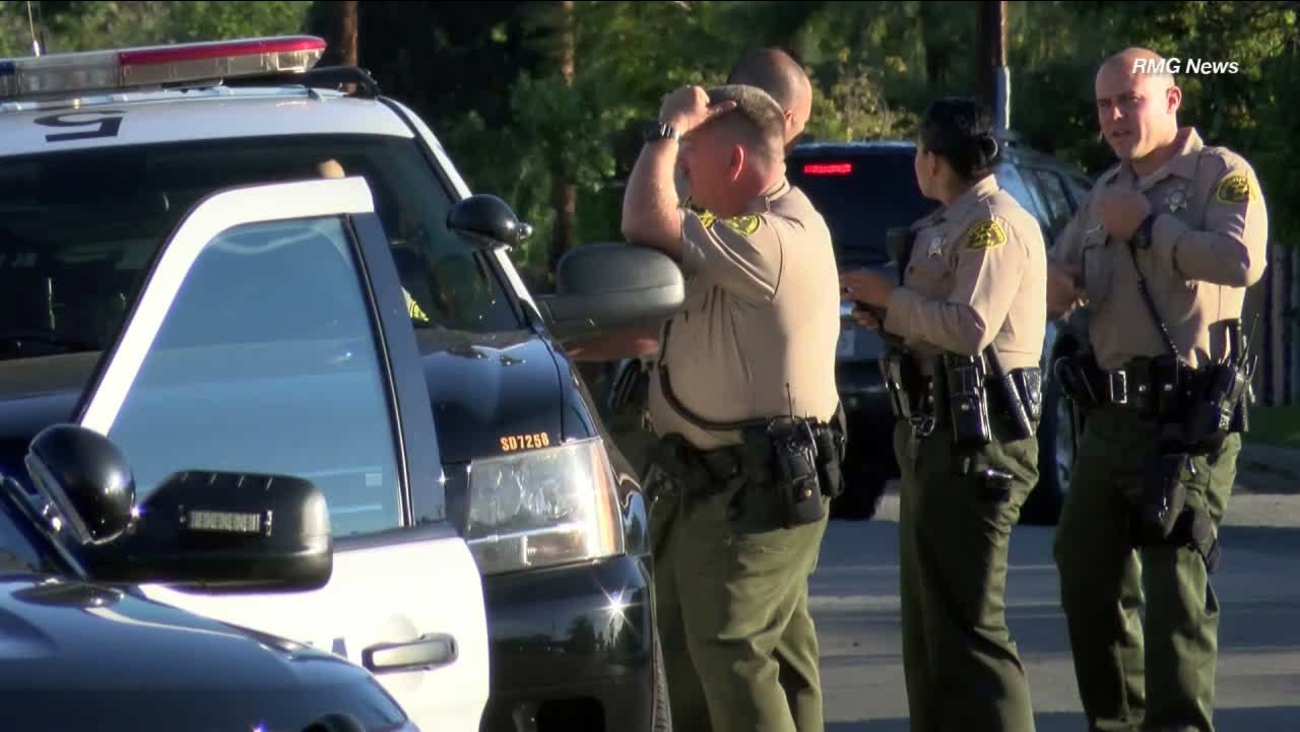 A woman's report of a rape at an abandoned building in Pasadena led to several people being led away in handcuffs.