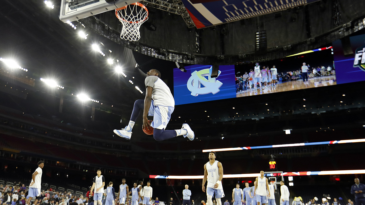 North Carolina's Theo Pinson dunks during a practice session for the NCAA Final Four college basketball tournament Friday, April 1, 2016, in Houston.