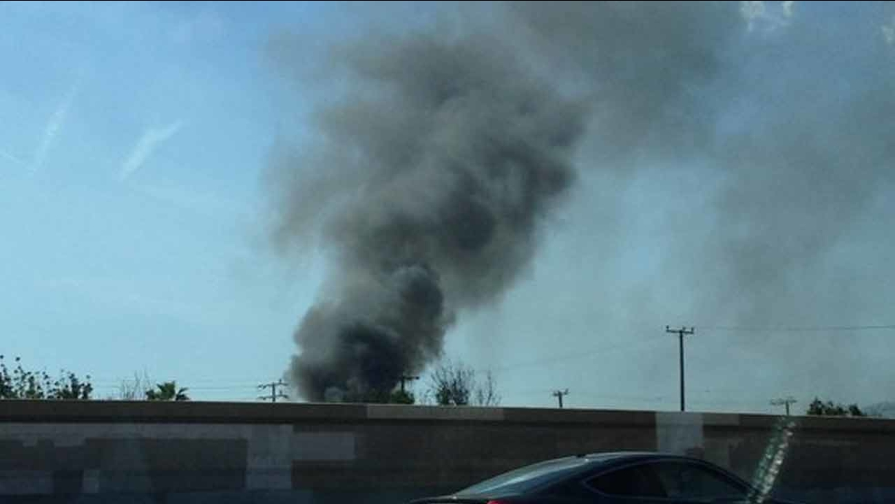 A photo taken by an Eyewitness News viewer shows smoke coming from a structure in Van Nuys, Calif. on Saturday, April 2, 2016.