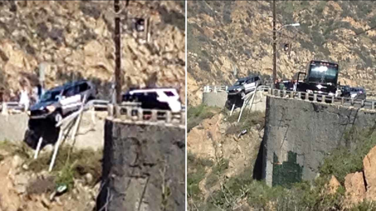 Images captured by ABC7 viewer Priscilla Kromnick show an SUV nearly falling over a ledge in Malibu on Saturday, April 2, 2016.