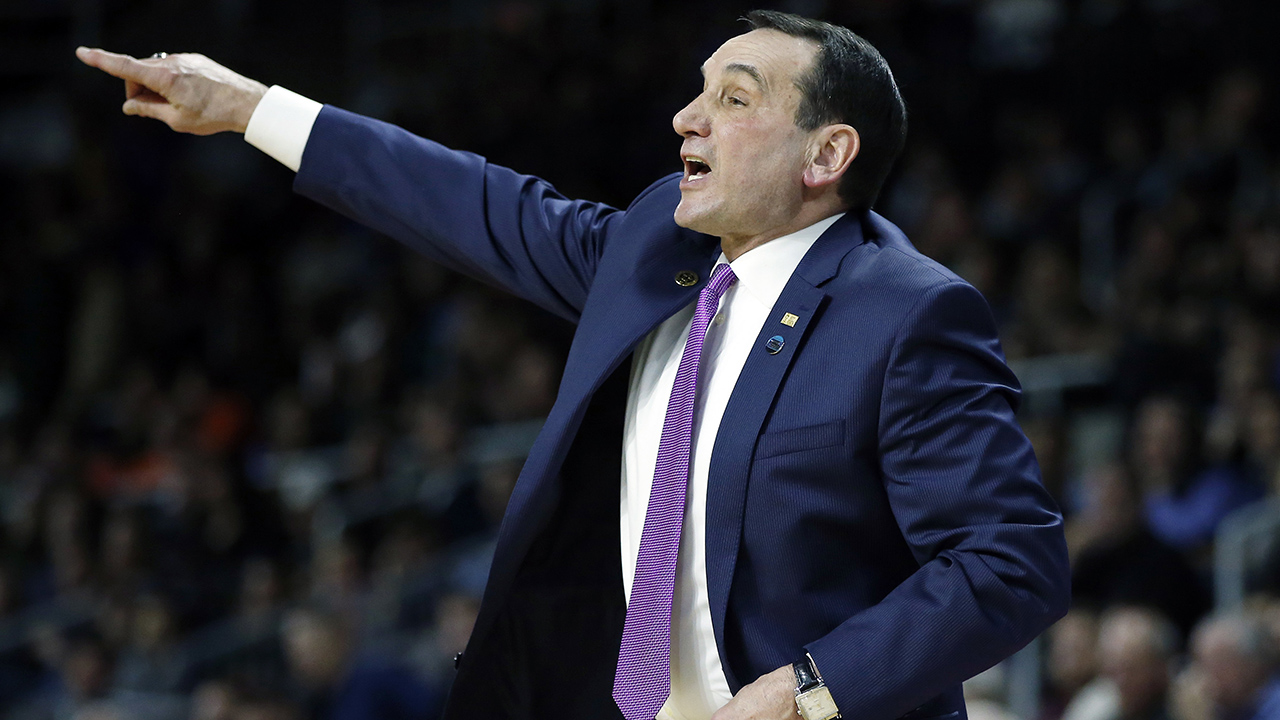 Duke head coach Mike Krzyzewski gestures during the first half of a second-round game against Yale in the NCAA men's college basketball tournament in Providence, R.I.
