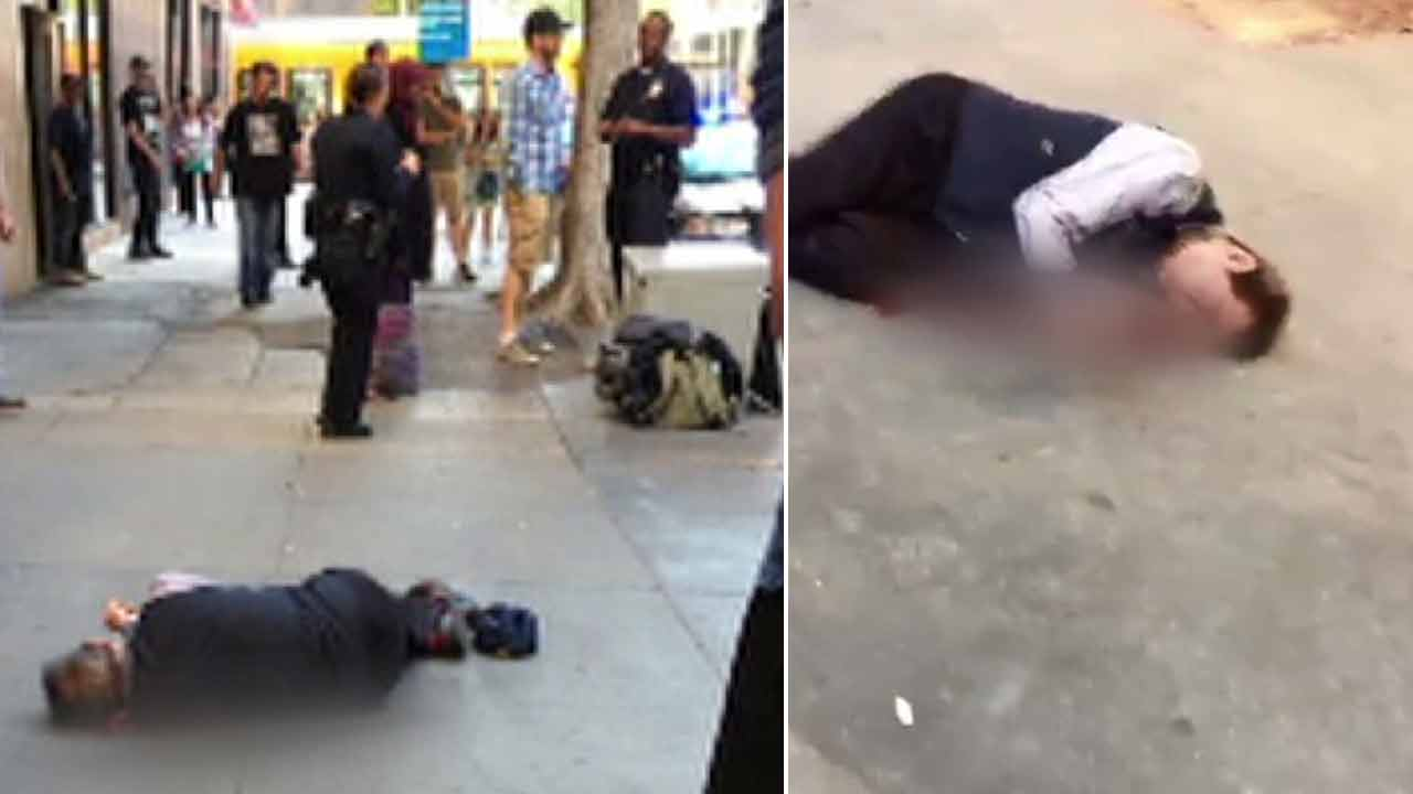 A man is seen beaten and on the ground after he was attacked by a suspect in downtown Los Angeles on Saturday, April 3, 2016.
