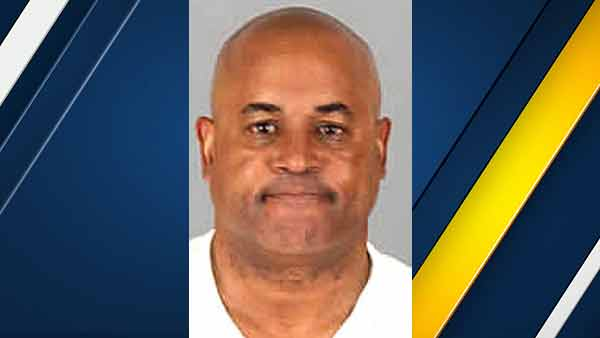 Christopher Samuel, 54, is seen in a mugshot issued by the Riverside County Sheriff's Department.