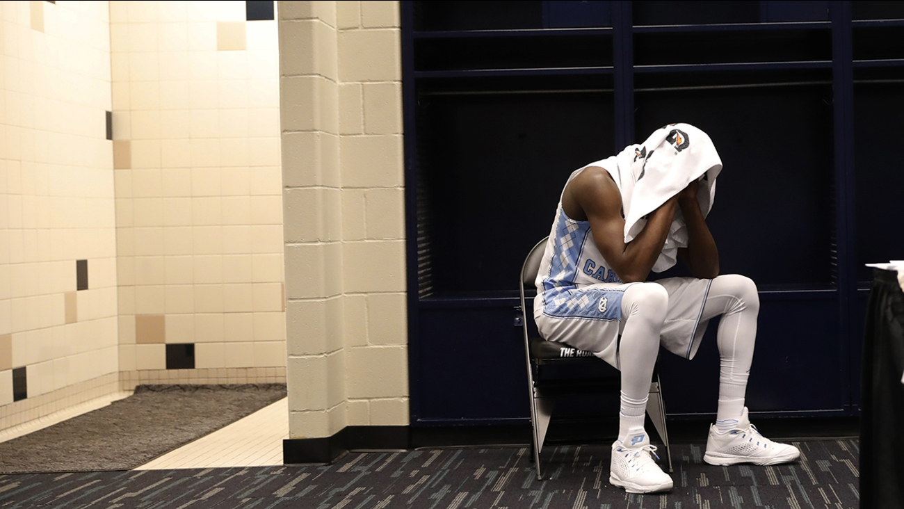 North Carolina's Theo Pinson sits in the locker room after the NCAA Final Four tournament college basketball championship game against Villanova, Monday, April 4, 2016, in Houston. Villanova won 77-74. (AP Photo/Eric Gay)