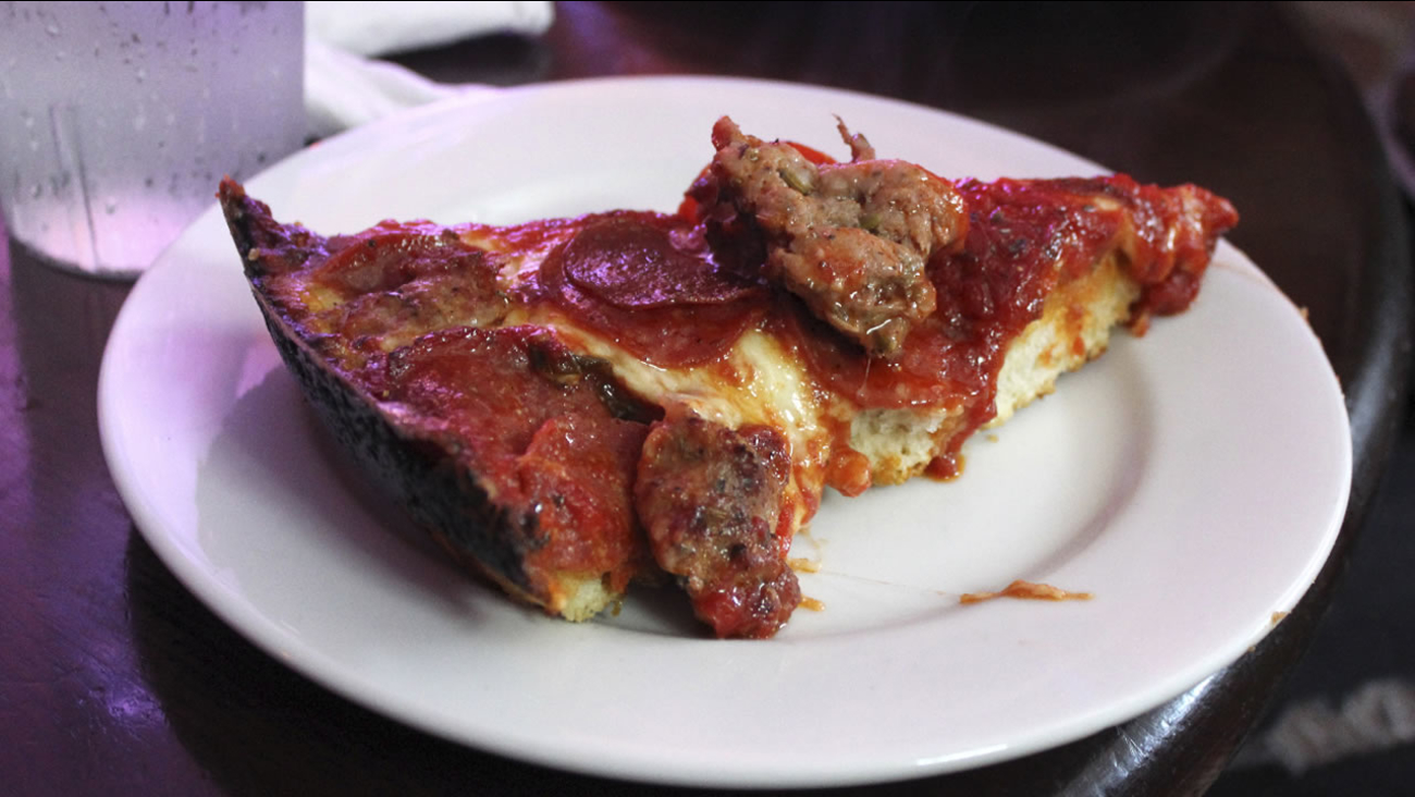 In this Sept. 5, 20143 photo, a slice of deep-dish pizza is shown at Pequod's in Chicago.