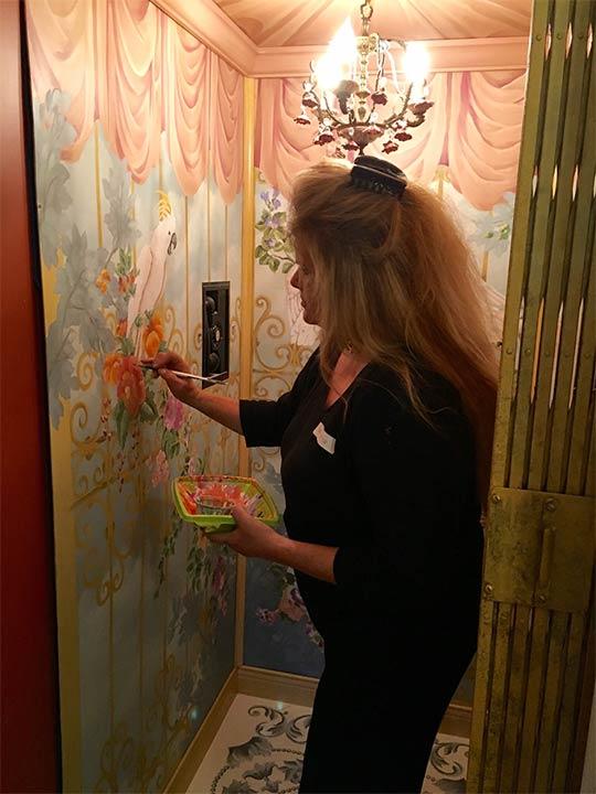An artist paints flowers inside the Dryborough Estate in La Canada Flintridge, this year's Pasadena Showcase House.