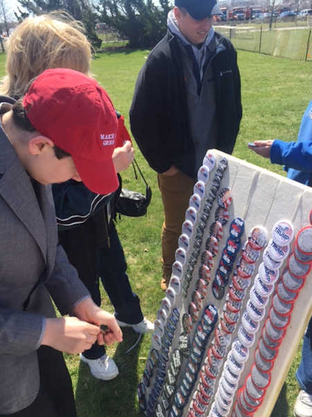 "<div class=""meta image-caption""><div class=""origin-logo origin-image none""><span>none</span></div><span class=""caption-text"">Demonstrators for and against Republican presidential candidate Donald Trump gathered before his campaign rally in Bethpage.</span></div>"
