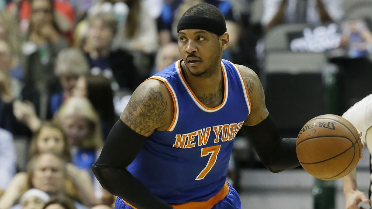New York Knicks forward Carmelo Anthony (7) dribbles drduring the first half of an NBA basketball game against the Dallas Mavericks Wednesday, March 30, 2016, in Dallas. (AP Photo/LM Otero)