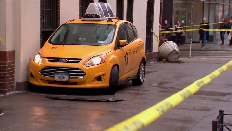 Woman critically hurt when cab jumps curb