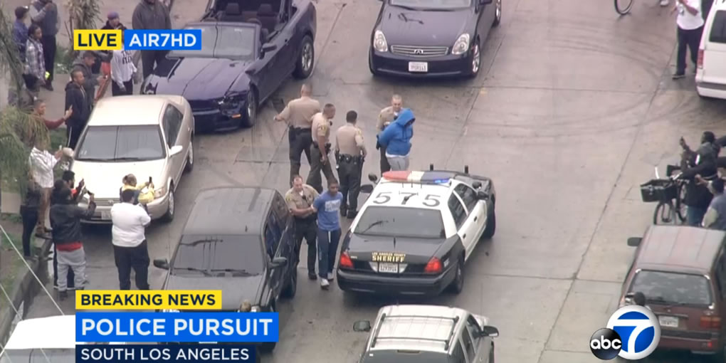 "<div class=""meta image-caption""><div class=""origin-logo origin-image kabc""><span>KABC</span></div><span class=""caption-text"">Two burglary suspects in a Ford Mustang led police on a chase through Los Angeles before pulling over to the side and waiting to be arrested on Thursday, April 7, 2016.</span></div>"