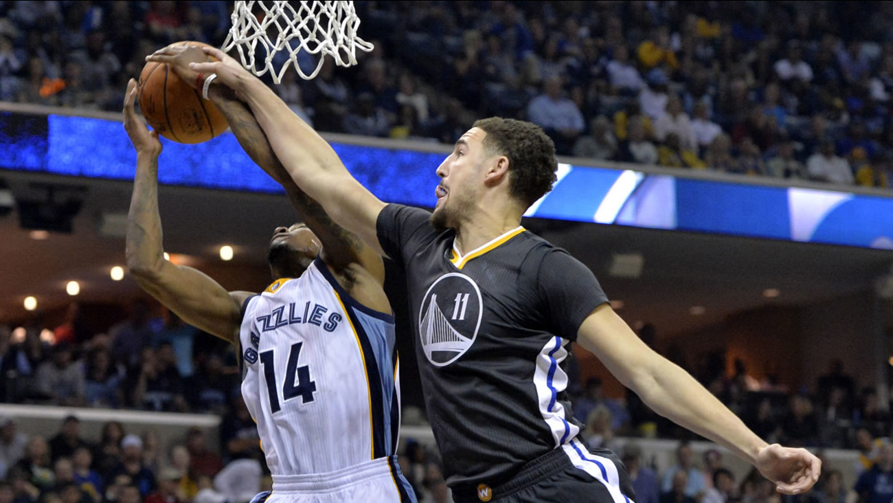 Memphis Grizzlies guard Xavier Munford (14) and Golden State Warriors guard Klay Thompson (11) compete for a rebound in the first half of an NBA basketball game April 9, 2016.