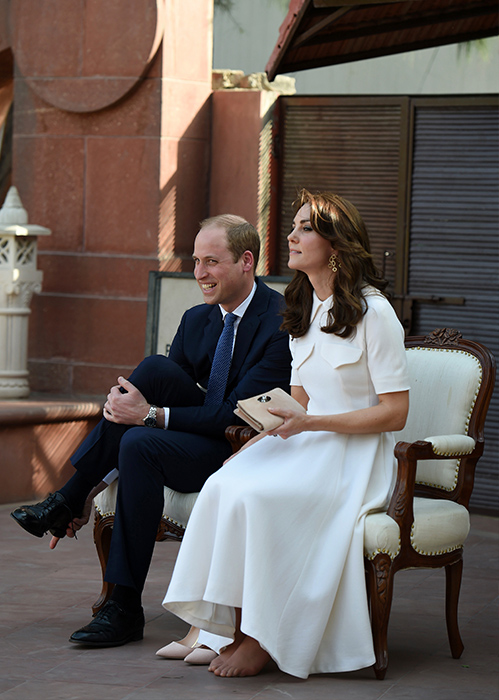 "<div class=""meta image-caption""><div class=""origin-logo origin-image ap""><span>AP</span></div><span class=""caption-text"">Prince William, the Duke of Cambridge, and his wife Kate, the Duchess of Cambridge, remove their shoes ahead of paying tribute during a visit to Gandhi Smiriti on April 11, 2016. (Prakash Singh/Pool Photo via AP)</span></div>"