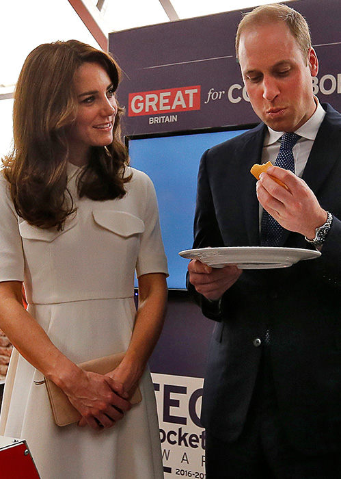 <div class='meta'><div class='origin-logo' data-origin='AP'></div><span class='caption-text' data-credit='Danish Siddiqui/Pool Photo via A'>rince William, right, eats a &#34;dosa&#34; or a rice pancake as his wife Kate, the Duchess of Cambridge, watches during an event on young entrepreneurs in Mumbai, India, April 11, 2016.</span></div>